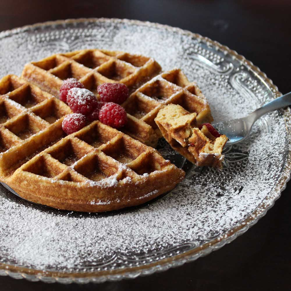 waffle topped with fresh raspberry