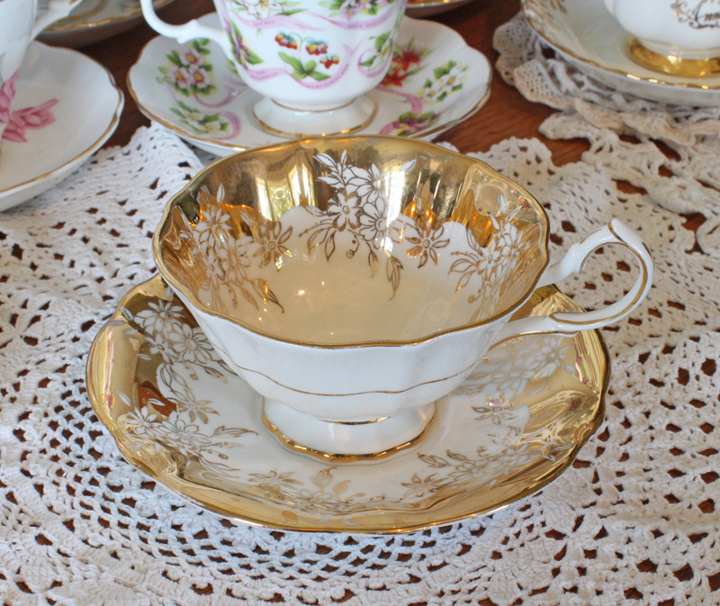 Queen Anne Bone China Teacup and Saucer gold and white