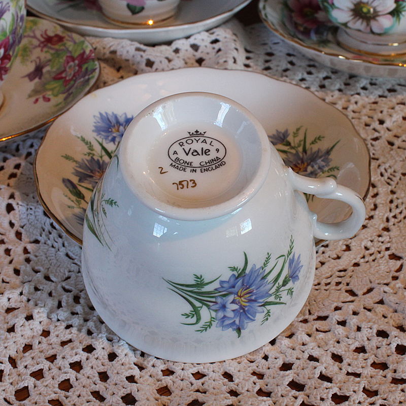 Royal Vale fine bone china Cup and Saucer Set. Made in England with a blue cornflower pattern trimmed in gold.